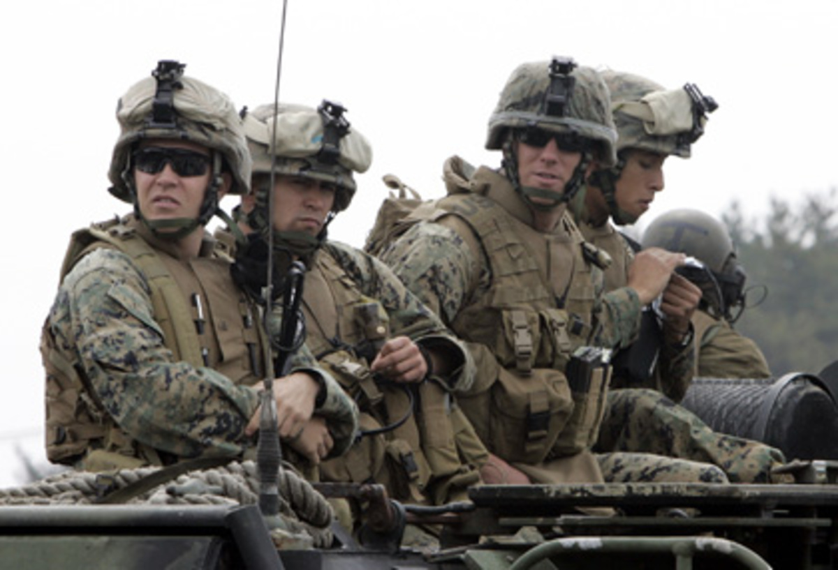 Government must cut military spending