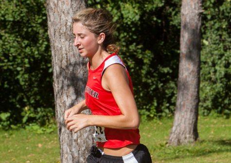 Natalie Harrison runs toward her goals