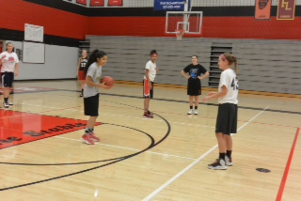 New girls basketball coach redefines team