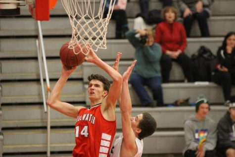 Boys basketball starts off behind, looking to improve