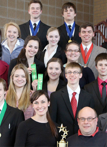 The SAHS speech team is a community of close-knit students who share a passion for public speaking. Junior Carly Johnson, shown second to the left in the second row, competed against the top 24 high school speakers in the state. Photo by Conor McClellan.