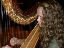 Playing the harp is one of the many instruments junior Brooke Knoll  has learned to play throughout her years as a musician.