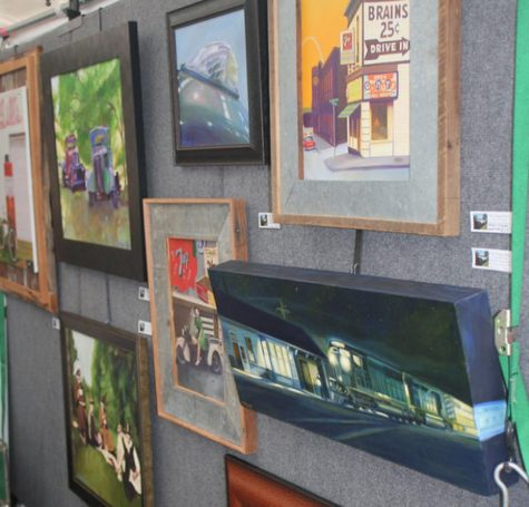 Various paintings are on display in a tent located at Art in the Park in Afton.