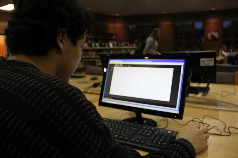Photo by Annika Kroll Working on Online Geography, junior Pedro Angulo-Umaña makes the library his study space.