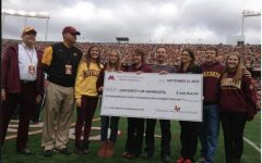 Sobiech family and friends present check to the University of Minnesota Medical Foundation.