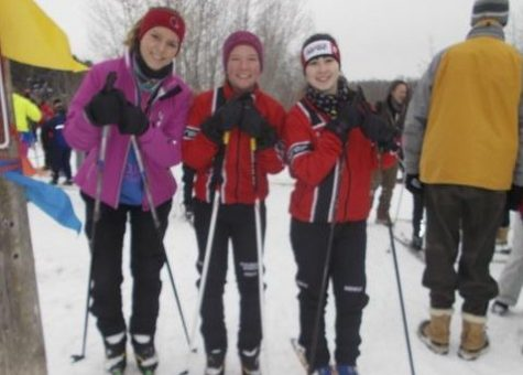 Juniors Emma Lundgren, Brittany Pooley and Emily Knowlan are ready to practice for the Nordic Ski season.