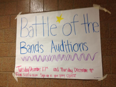 "Photo by Lexie Sherrick</strong><br /> Abby Farmer said the instant she saw the posters around school for Battle of the Bands she was excited. ""While I am not in a band, I am looking forward to seeing friends of mine who are,"" said Farmer."