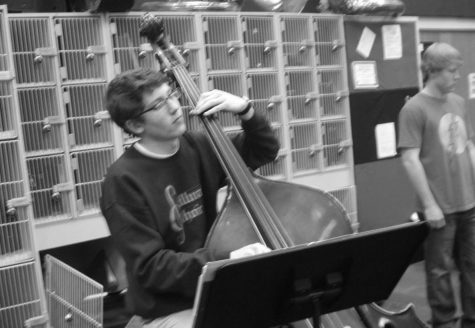 """Senior Nick Benish playing the cello in one the many music programs he is involved in. Benish said, """"It's hard to imagine what my life would be like without music."""""""