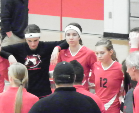 The Varsity volleyball team huddles up as they end another successful season with middle hitter Stephanie Dietrich ('14). From left to right: Stephanie Houle ('14), Stephanie Dietrich, and Janae Momchilovich ('14). Dietrich will be playing volleyball at Michigan Technological University this upcoming fall.