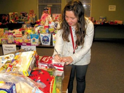 Senior Paige Hietpas helps with Holiday Hope, a program that helps Stillwater families in need during the Christmas season.