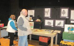 Students browse the art at the eighth annual Da Vinci Fest.