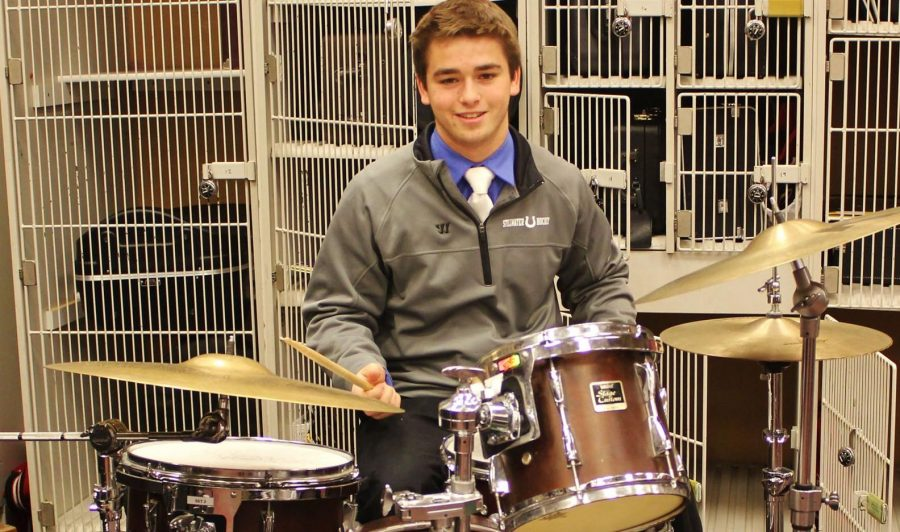Junior Aidan Lee is a highly involved student with extracurricular activities that include not only scuba diving, but also playing the drums in the school band.