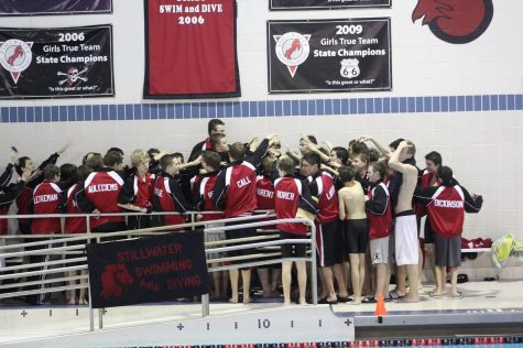 Swim team pushes themselves to improve