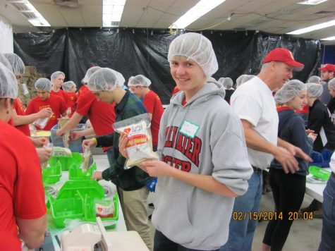 """Many Stillwater students, such as Erik Nelson ('16) volunteer for organizations such as Meals from the Heart to pack meals which will then be shipped off to families in need. """"It's had a huge impact on my life,"""" said junior Catherine Wessel. """"I've always loved mission work and directly helping the poor, and it's just the perfect way to get involved and save another person's life without even having to go to their country. """""""