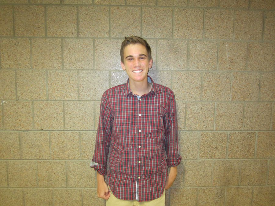 """Junior Matthew Treacy poses for picture before tennis practice. """"It was definitely a building year, and hopefully with more upperclassmen and experience we can hold a better record,"""" said junior Matthew Treacy."""