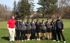 The girls golf team poses for a picture after the round at North Oaks golf course with new head coach Peter Deeg on the right.