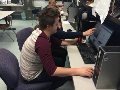 "Senior Paul Hudachek works hard to make the publication as strong and high quality as his individual writing. ""I felt pretty content with my writing and design portfolios,"" said Hudachek upon compleating his application."