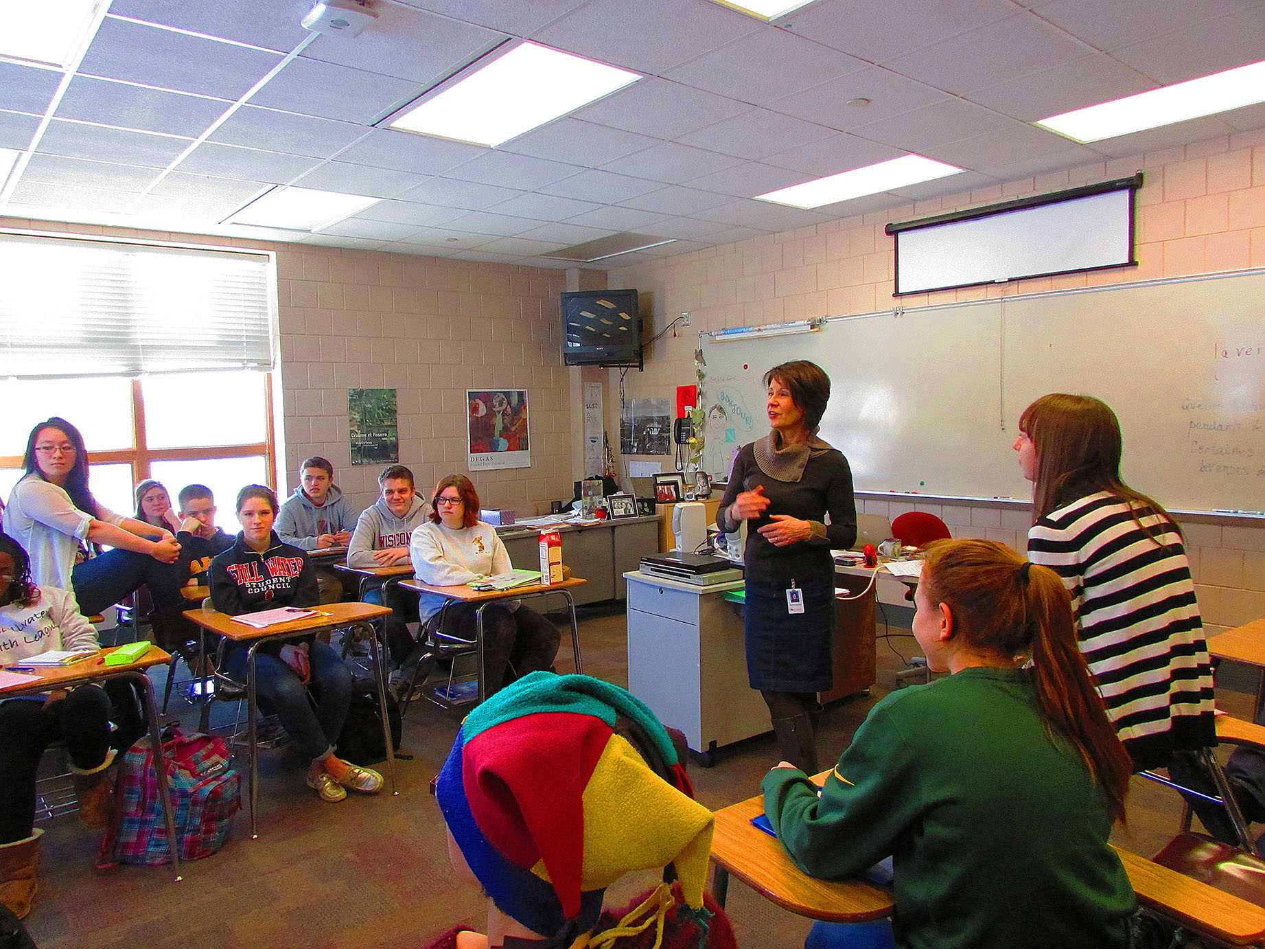 "Photo by Paul Hudachek  Kasak-Saxler teaches her students French during the day and is also a favorite of the students. ""I learned to really try hard with my French from her. I would consider her as a role model because I admire that she has kept up with French over all these years, and I want to do the same,"" said senior Chandler Stormo."