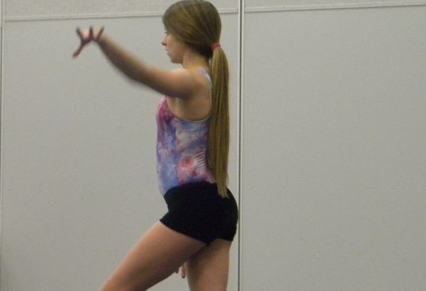 Photo+by+Megan+Friederichs+%3C%2Fstrong%3E%3Cbr+%2F%3E+Absolute+concentration+is+required+for+some+of+the+moves+that+are+pulled+off.+Senior+captain+Marleigh+Wise+said%2C+%22As+a+captain+I+work+to+set+an+example+and+motivate+the+team+to+perform+the+best+they+can.+All+the+captains+are+there+to+connect+the+team+to+make+sure+we+are+there+for+each+other+and+support+each+other+everyday.%E2%80%9D