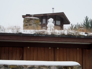 """A lone, faceless snowman is perched outside of an abandoned educational center at William O'Brien State Park. The Naturalist Club trekked through the fresh snow on Nov. 22. Hiking is one of the first activities the new club has done together.  """"It went very well,"""" said social studies teacher Mike Lennon. """"I had two kids show up that I hadn't expected and two moms came which was nice."""""""