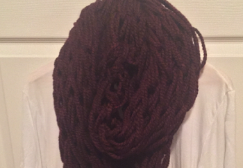 Arm knit scarves are the new popular accessory, they look good with anything.