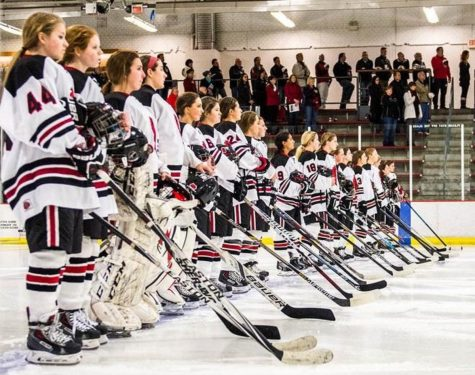 "Photo Courtesy Katie Lottsfeldt The varsity hockey team lines up for the national anthem at St, Croix Valley Rec Center before a game. ""I think our biggest win was the section quarterfinals against White Bear. We had a rocky start but then came back together as a team,"" said Katie Lottsfeldt"