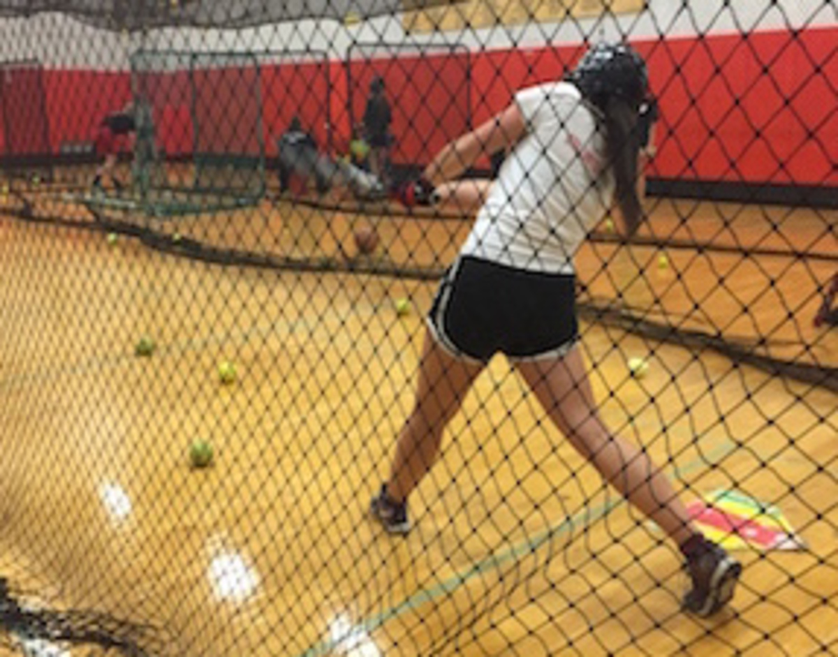 Girls fast pitch softball swings into season