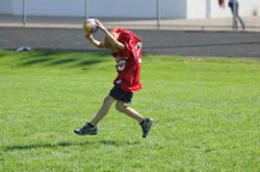 Pictured here is another adaptive football athlete.  The kids were taught the basic of football like catching throwing and scoring touchdowns. Football Coach Beau Labore said,