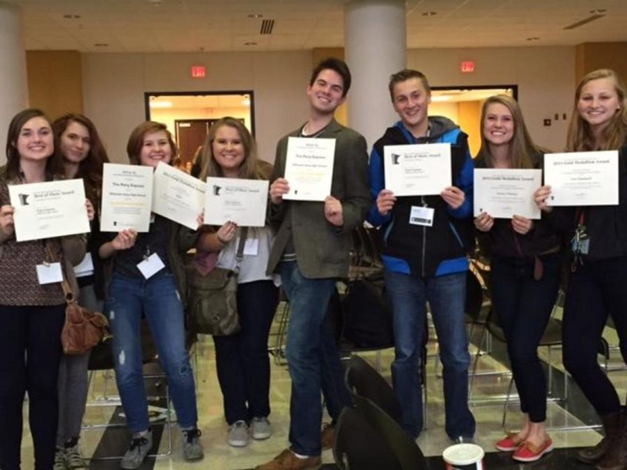 Seniors of the Pony Express proudly stand together with their awards from the MHSPA convention.