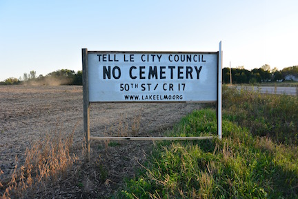 A local protest sign sits off of Lake Elmo Avenue protesting new building of a local cemetery. Mayor Mike Pearson describes citizen controversy by saying,