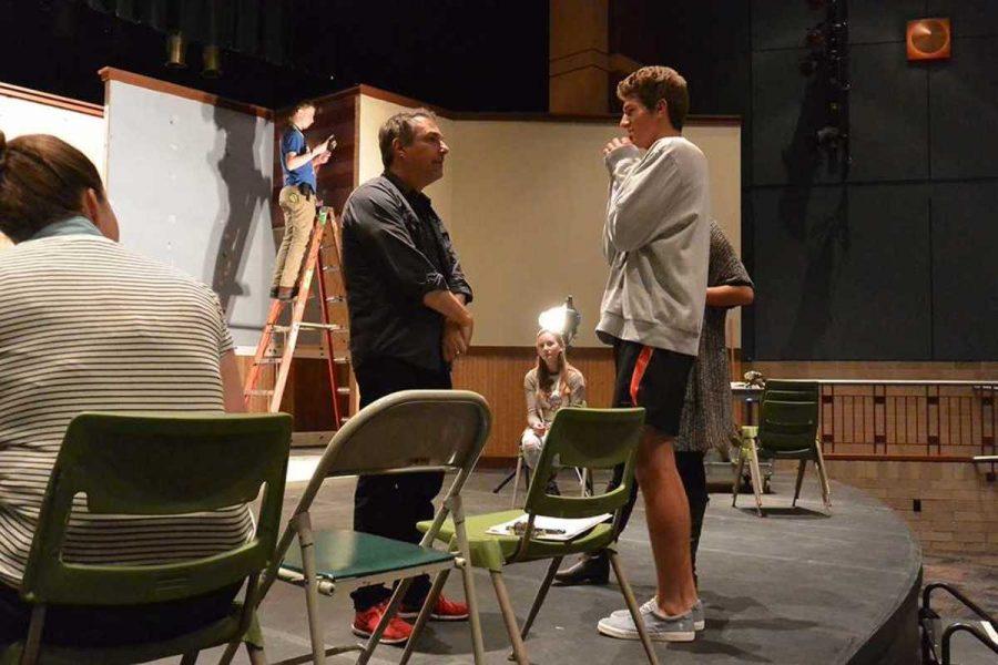 Director Sadow consults with senior Simon Leppicello.