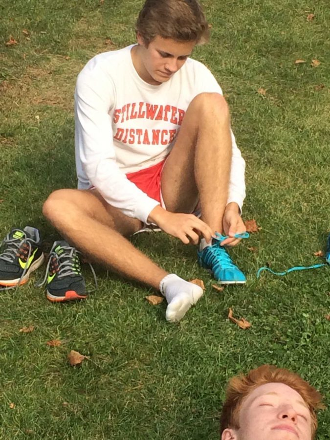 Sam+Hanson+laces+up+while+Joe+Weber+takes+a+break