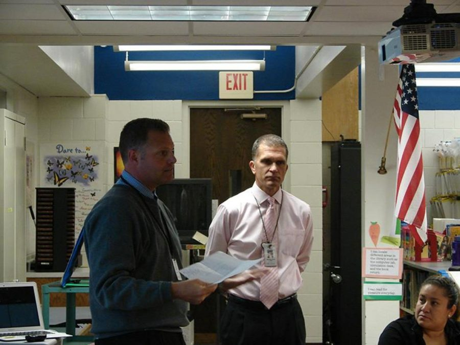 """Oak-land Jr. High principal Andrew Fields presents the positive outcomes of this change while answering the questions of the parents. Fields said, """"Looking at opportunities to connect our Lake Elmo and Valley Crossing students, and to help with the middle school transition that will be taking place in 2017-18 also looking at the opportunities for our students to have a Jr. High/Middle school spaces available to them."""