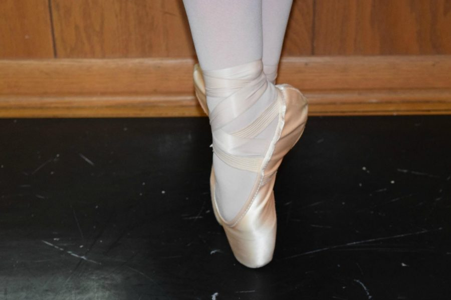 Pointe+shoes+are+used+in+the+Nutcracker+to+provide+a+sense+of+floating+for+the+female+dancers.+Junior+Grace+Gualtieri+displays+what+it+looks+like+when+a+dancer+is+on+releve+on+pointe+shoes%2C+%E2%80%9CThese+shoes+are+beautiful%2C+but+can+also+be+very+painful+at+times+and+can+create+a+lot+of+injuries.+Adding+pointe+shoes+to+a+dance+or+choreography+makes+the+piece+more+difficult+and+adds+a+challenge+to+it%2C%E2%80%9D+junior+Mckenzie+Brady+says.