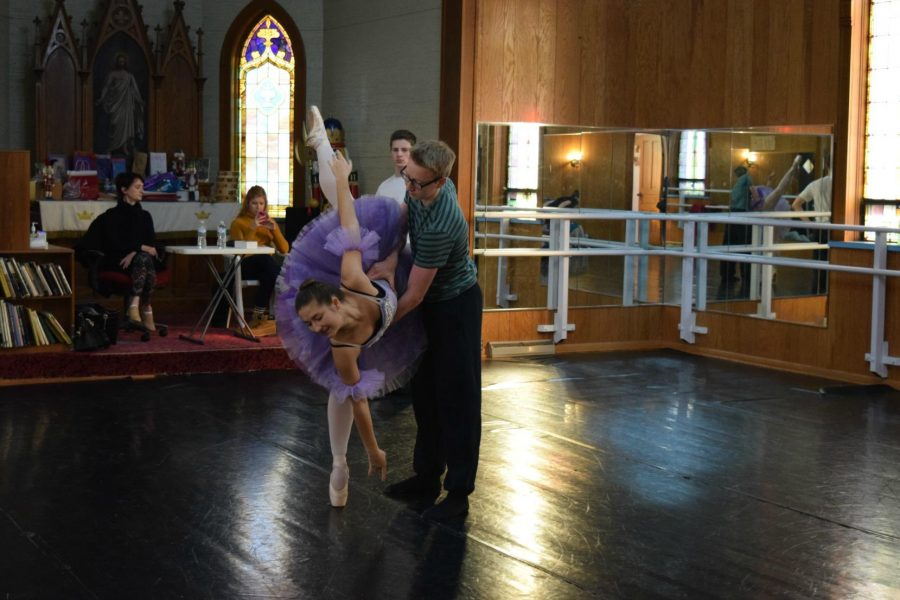 """Senior Ava Wichser rehearses her """"Dance of the Sugar Plum Fairy"""" with Joseph Roesler as one of the Sugar Plum Cavaliers. """"I love to dance because there is always room to improve and push yourself more and more,"""" Wichser says."""