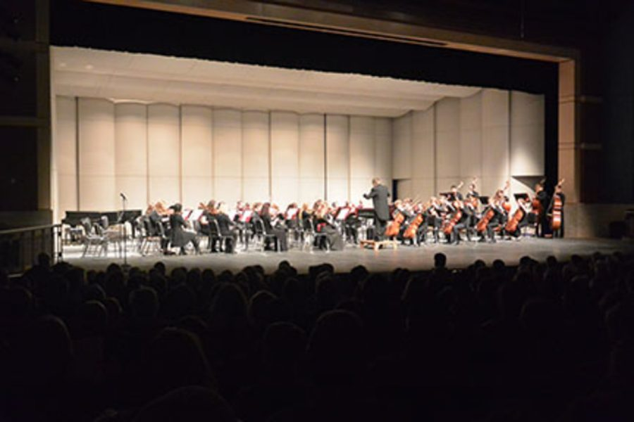 The symphonic orchestra playing during their concert in a packed auditorium. The Orchestras had been working hard to insure they were ready for their concert. Junior Emmery Hartwig explained,