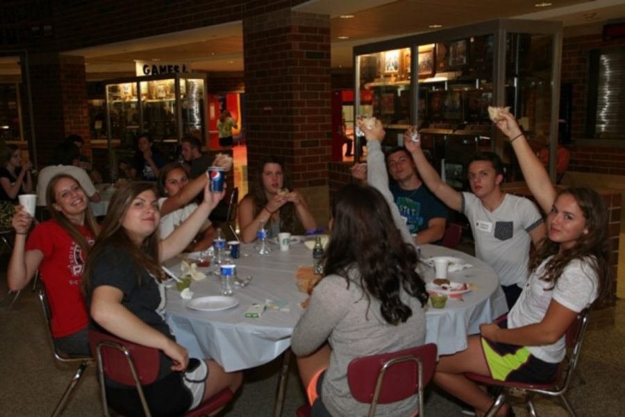 A few seniors including Sophia Portelli, Emily Weigand, Ashlyn Jelinek and Anna Corman enjoy some of the great food the senior class party has to offer. Local restaurants such as Chipotle, Acapulco and Buffalo Wild Wings donate food for the new graduates at their senior party.