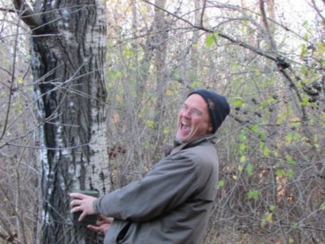 Biology teacher at SAHS for 25 years, Andrew Weaver cracks a joke as he installs trail cameras with his first hour AP Environment Science class. The class is installing 4 cameras in the Environmental Learning Center,