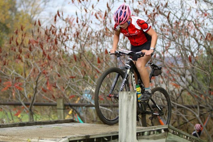 Sophomore+Siri+Bohachek+climbs+over+an+obstacle+for+her+first+place+finish+at+the+Minnesota+state+mountain+biking+race+in+Mankato.+%22Whenever+I+take+part+in+Mountain+Biking+or+Nordic+I+feel+those+are+the+sports+that+I%27m+best+at+and+are+the+most+fun+for+me%2C+I+have+the+best+experiences+on%2C+I+don%27t+regret+taking+part+in+them.%22+Bohachek+said.