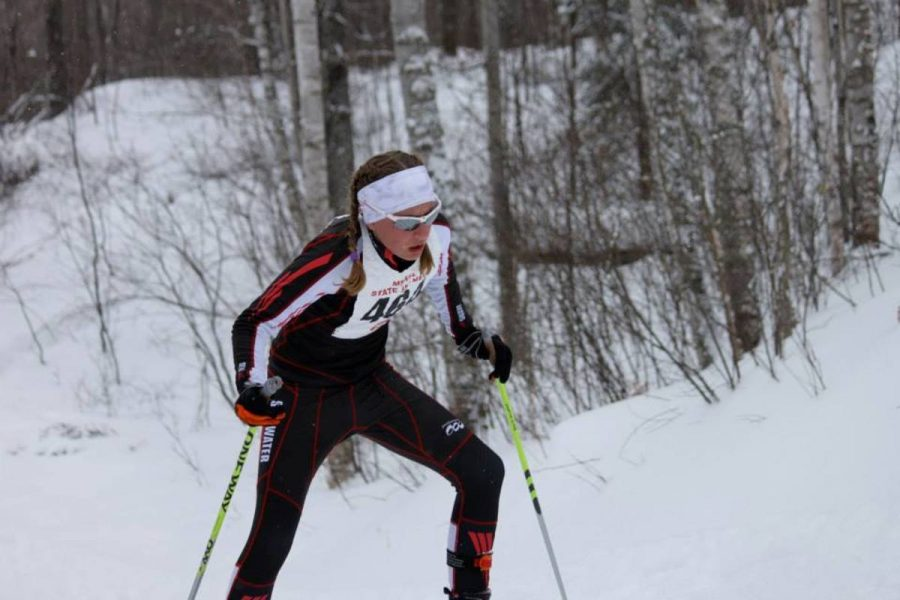 Sophomore Siri Bohachek climbs up a hill at the nordic state tournament last year for the girls teams third place finish.