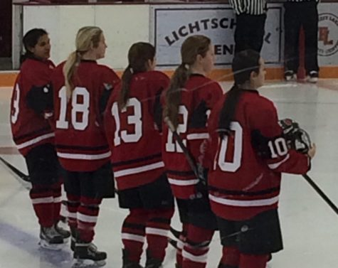 "Ana Reding, Olivia Arkell, Lauren Greeder, Olivia Konigson and Abbi Paduano lining up to sing the national anthem on Dec. 10 game against Forest Lake. Senior Olivia Arkell and senior Lauren Greeder are this year's hockey captains. ""Honestly I just try to be a leader and try to make it fun. I do not like to tell people what to do so I just encourage them in a different way,"" Greeder says why she thinks she got chosen to be a captain this year."