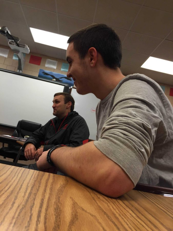 Senior Aj Laudet and FCA Advisor Brad Madison participating in the discussion during a FCA meeting.
