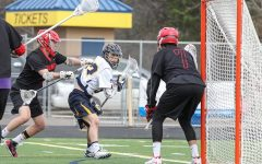 Senior Max Evenson (#2) defending the goal last year against Mahtomedi in the section  tournament. He looks to be a leader on the team this year and hopes to make a solid run in the post season. Evenson said,