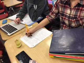 In Mrs. Handbergs chemistry class, students work with their lab partners to fill in answers on a worksheet.