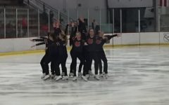 "The varsity figure skaters showing their finishing move to the crowd of hockey fans. ""Our program is just beginning and I thought it sounded like a blast when I found out about it,"" senior Lilia Pugh, co-captain of the varsity figure skating team says."