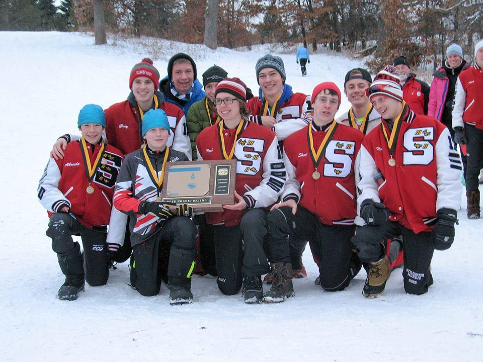 The Varsity boys team triumphantly pose with their first place plaque after their win at battle creek this past January 26th. (Front row left to right) junior Josh Albrect, 7th grader Caden Albrect, junior Noah Kneeskern, junior Shad Kraftson, junior Nolan Noer (back row) junior Colin Gray, sophomore Jack Lange, sophomore Brian Olson, senior Seth Cattanach, senior Sam Hanson.