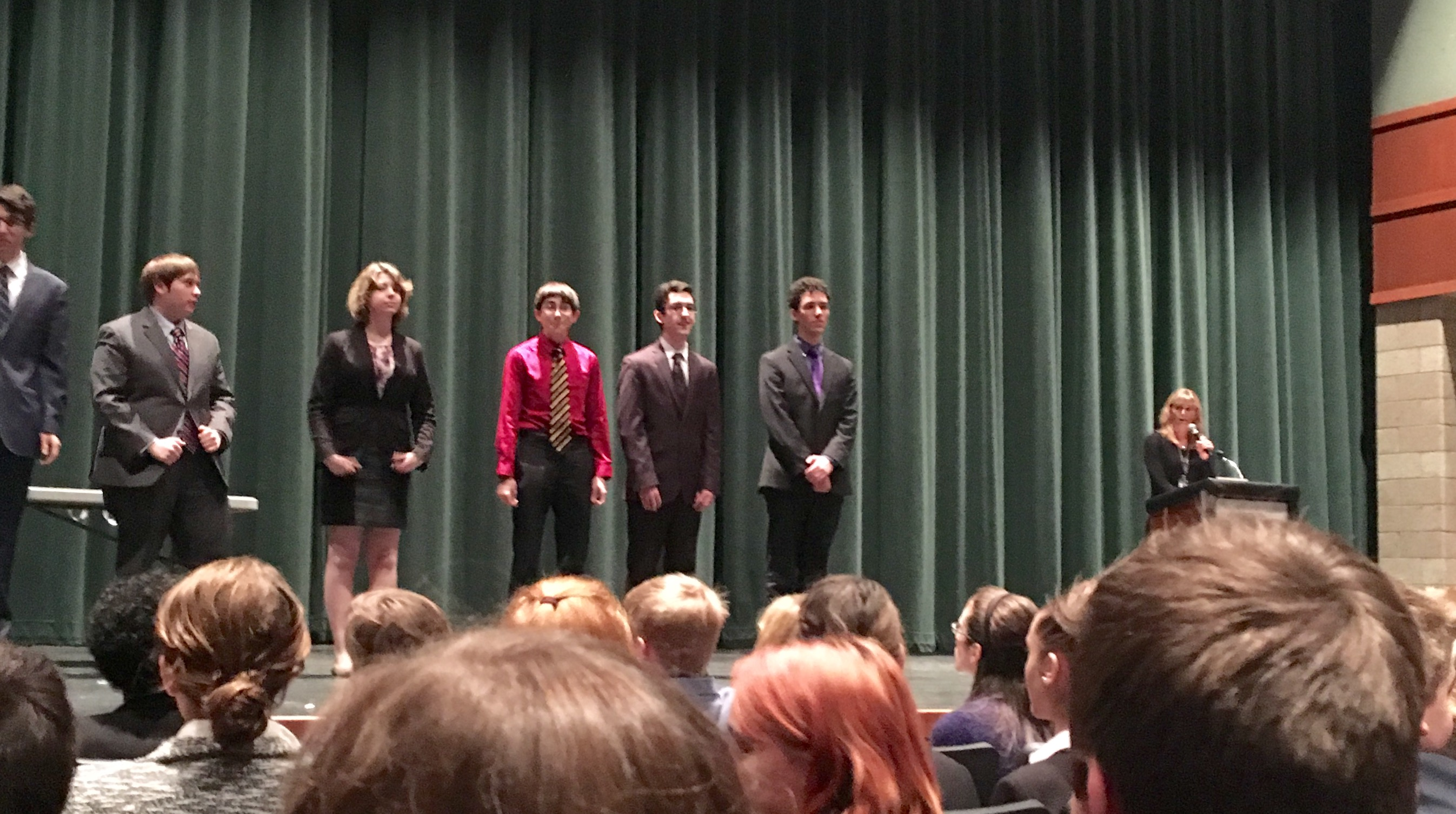 Noah Schraut, Daniel Meyer and Ace Oubaha (left to right) are on the stage awaiting their awards.