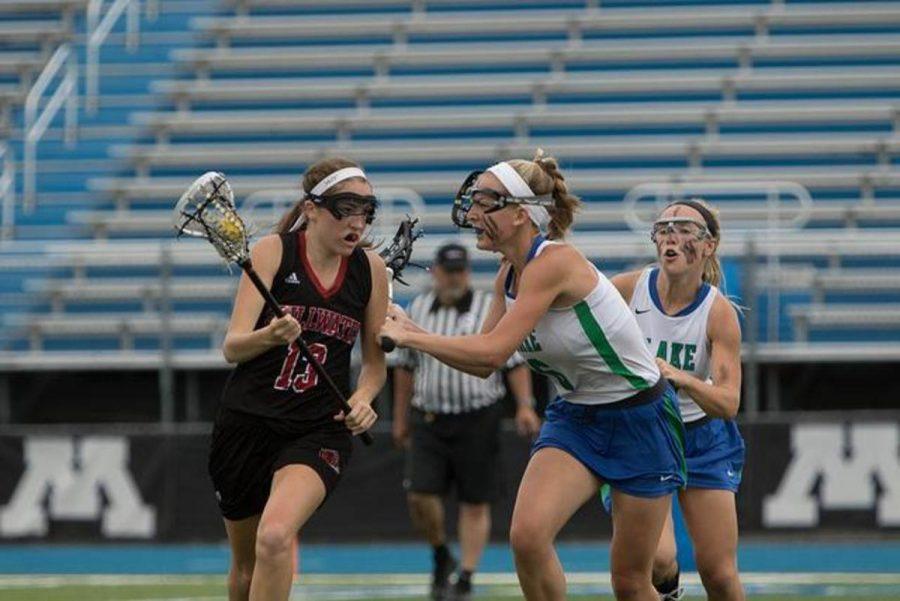 Senior Carly Fedorowski runs down the field against Blake in the 2015 girls lacrosse season.