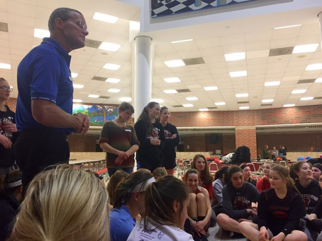 The girls lacrosse team listens as Raisser talks about how to maintain a positive mindset during the season.