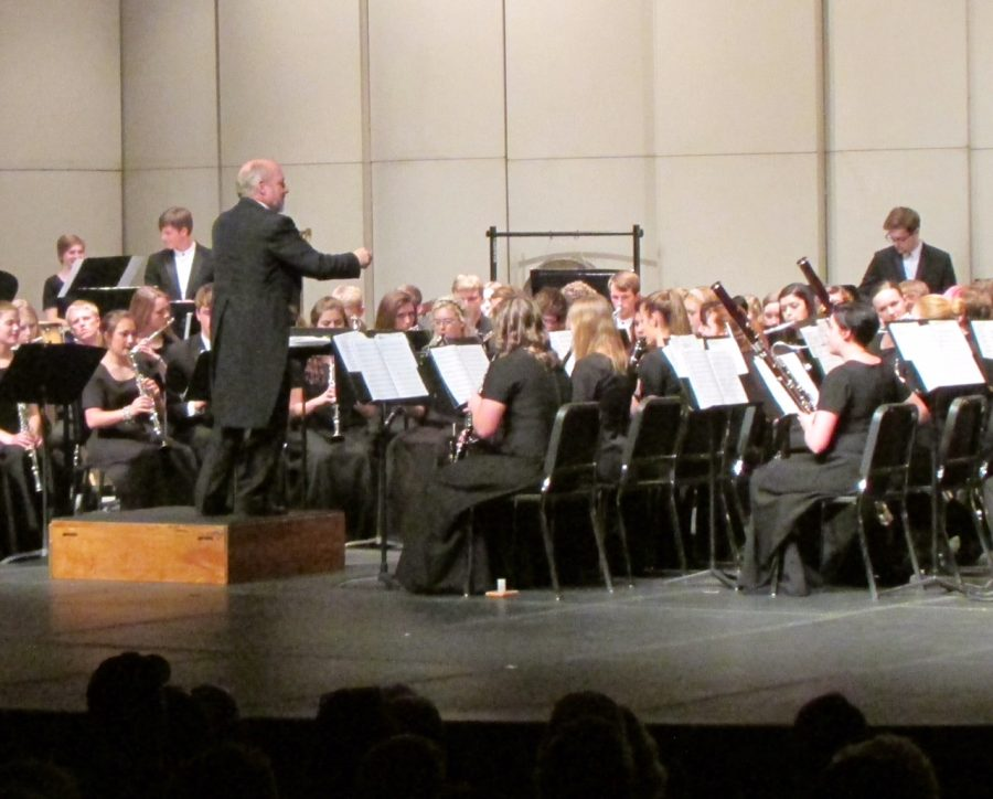 Dennis Lindsay conducts his band at the recent Wind Symphony concert. All eyes are on him as they play.